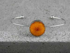 """Bracelet rigide en lave émaillée collection """"cristal"""", orange, L'île o Pierres."""